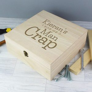 Buy him this personalised handy man crap box for this anniversary gift, sort of a small man cave for his bits and bobs he keeps leaving laying about