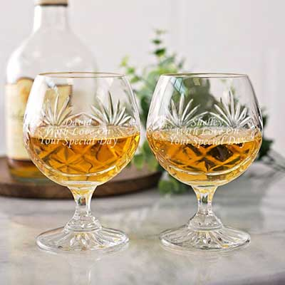 Buy him or the celebrating couple these engraved crystal cut brandy glasses for this anniversary gift