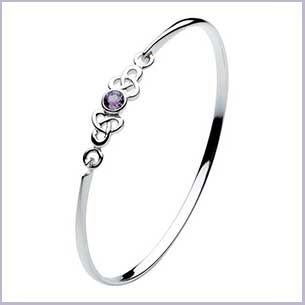 Buy her the Heritage Set Kalin Celtic Trilogen Round Stone Bangle for this anniversary gift