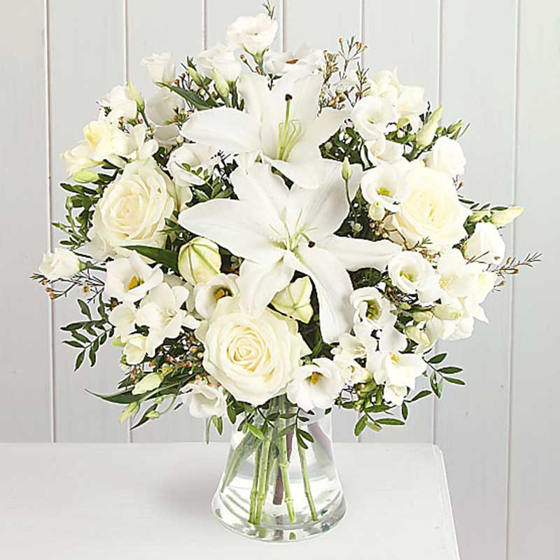 Buy her or the couple this Peace Bouquet full of beautiful white flowers for this anniversary gift
