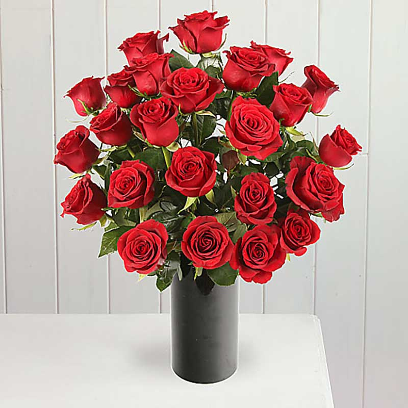 Buy her or the celebrating couple two dozen red roses for this anniversary gift