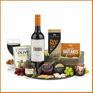 Buy the cheese and red wine hamper for this anniversary gift, perfect for relaxing with some fresh fruit in your garden
