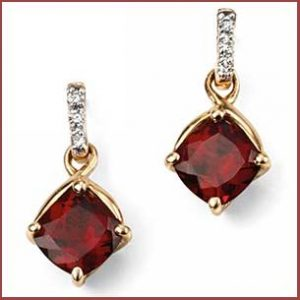 Buy her these Elements 9ct Yellow Gold Garnet Earrings for this anniversary gift