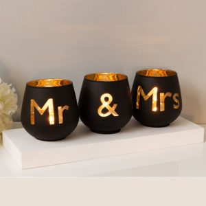 Buy them these Mr & Mrs tealight holders for this anniversary gift