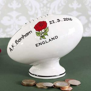 Buy him this Personalised Hand Painted China Rugby Ball Money Box for this anniversary gift
