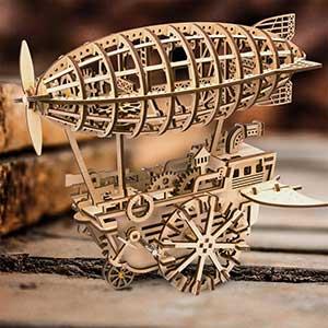 Buy him the Flying Machine Blimp Wooden Model Kit for this anniversary gift