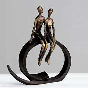 Buy them the Harmony Couple on a ring Sculpture in Bronze Finish for this anniversary gift