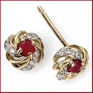 Buy her these gold and ruby with cluster diamonds earrings for this anniversary gift