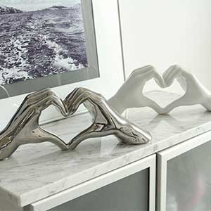 Buy these Heart Ceramic Set Of 2 Hand Sculpture In Silver And White for this anniversary gift
