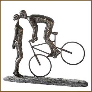 Buy the Kiss Me Poly Design Sculpture In Burnished Bronze And Grey for this anniversary gift