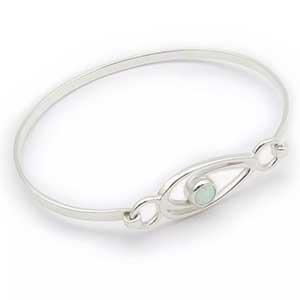 Buy her the Ortak Silver and White Opal Swirl Bangle for this anniversary gift