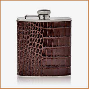 buy him the stainless steel 6 oz flask is wrapped with Crocodile Embossed leather for this anniversary gift