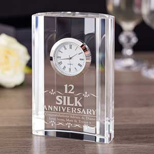 Buy them the 12th Silk anniversary clock with engraved dates for this anniversary gift