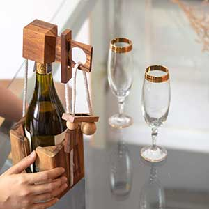 Buy him or her the wine bottle puzzle, great for get togethers with friends and anniversary gift